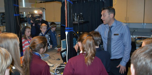 UBC Assoc. Prof. Jonathan Holzman tours school children through his engineering lab at Celebrate Research week 2014.