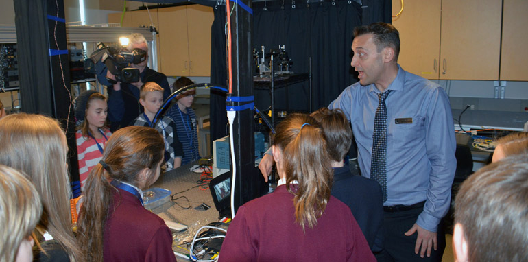 UBC Assoc. Prof. Jonathan Holzman tours school children through his engineering lab at Celebrate Research week 2014.