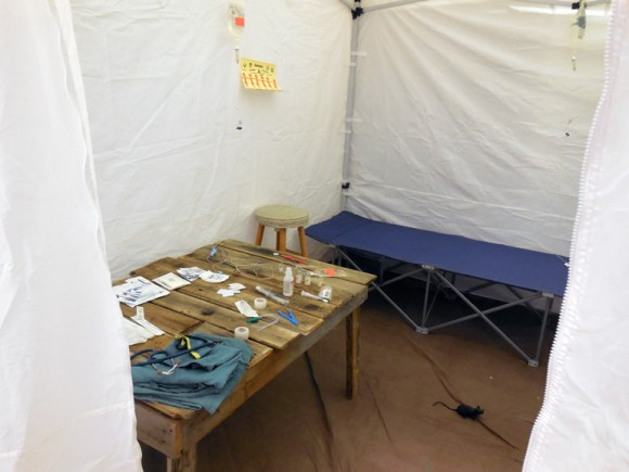 A medical tent, complete with a rat, shows the stark reality of medical care in many countries around the world.