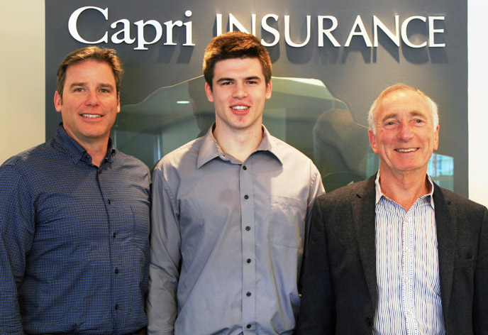 Capri Insurance's Tim Miller and Robin Durrant congratulate student athlete Buster Truss (centre) on being the sixth recipient of the annual Capri Insurance Athletics Entrance Scholarship.