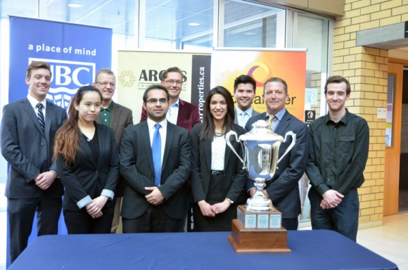 Douglas Canning, Siqi Tan, Faculty of Management Dean Roger Sugden, Aneeq Siddiqui,  Totalamber CEO Alan O'Neill, Regina Gonzalez Garcia, Davis Yates, Argus Properties CEO Ted Callahan, and David Kuhn pose with the Argus Cup at the Live Case Challenge.