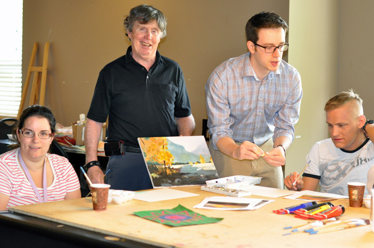 UBC Okanagan medical student Maksim Parfyonov, second from right, leads the weekly art class with Connect residents Amadee Hollowink, Glen O'Connor, and Matthew McKay.