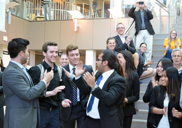 Management students Davis Yates, David Kuhn, Douglas Canning, Regina Gonzalez Garcia, and Aneeq Siddiqui celebrate after hearing their team won the Argus Cup and the $5,000 grand prize.