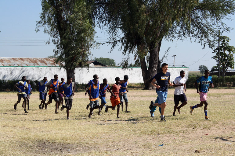 Tim Krupa trains with the Junior Leopard Football Club in rural Senanga, Western Province of Zambia. Photo by Alexa Geddes