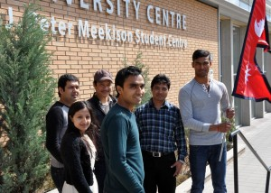 UBC Okanagan students (left to right) Dinesh Adhikary, Upama K.C., Kumar Shrestha, Sudip Shrestha, Gyan Shrestha, and Omy Shah are hosting a candlelight vigil Sunday evening at Stuart Park to honour the thousands killed in last week's earthquake.