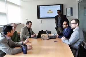 Rehan Sadiq, left, meets with fellow School of Engineering professors, Lukas Bichler, Ahmad Rteil, Kasun Hewage, (standing), Shahria Alam, and Joshua Brinkerhoff to discuss the four-year plan for their research project.