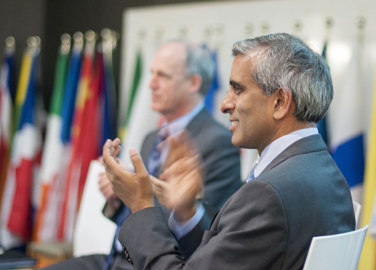 UBC President Arvind Gupta, right, and Okanagan College President Jim Hamilton applaud the creation of the Okanagan Charter calling on universities and colleges to embed health into campus operations, business, academics, and campus culture, and to lead health promotion action and collaboration locally and globally.