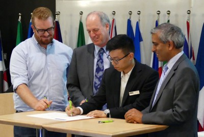 Historic first signatures are added to the Okanagan Charter at UBC Okanagan Thursday afternoon. From left, Tom Macauley, President of the UBC Students' Union Okanagan, Jim Hamilton, President of Okanagan College, Enoch Weng, President of the Simon Fraser University Student Society, and Arvind Gupta, President of UBC.