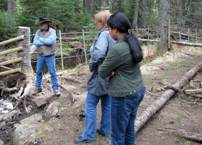 Rob Dinwoodie, with BC Ministry of Forests, Lands and Natural Resource Operations, meets with UBC professor Deborah Roberts and research student Nusrat Urmi at a nose-hole on a creek. The nose-hole is built specifically so cattle can access water without wading into it.