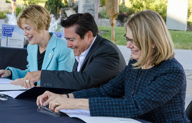 Signing the renewed memorandum of understanding on Tuesday afternoon were, from left, UBC Interim President Martha Piper, Westbank First Nation Chief Robert Louie, and UBC Deputy Vice-Chancellor and Okanagan Principal Deborah Buszard.