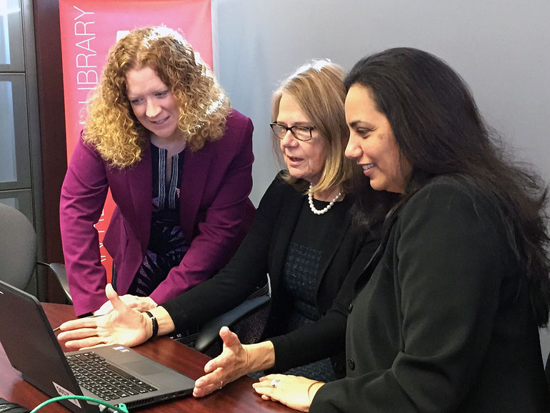 UBC Okanagan chief librarian Heather Berringer, DVC Deborah Buszard, and Pilar Portela, with Accelerate Okanagan, search UBC digital records at the opening of the UBC Innovative Library inside the Kelowna library Thursday.