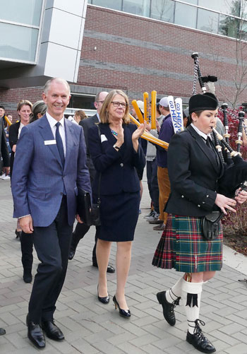 Piper Brittany Crooks leads UBC Chancellor Lindsay Gordon, UBC Deputy Vice-Chancellor and Principal Deborah Buszard, and other dignitaries to view the donor wall during the start an evolution campaign celebration last week.