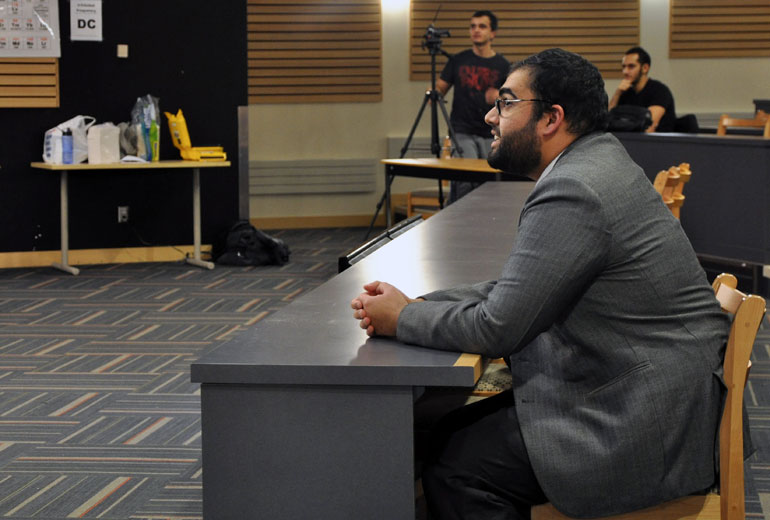 "Adnan Bhat listens while Shaykh Navaid Aziz, a chaplain and youth counsellor from Calgary, answers questions during the ""Misconceptions about Islam"" event held at UBC Okanagan this week."