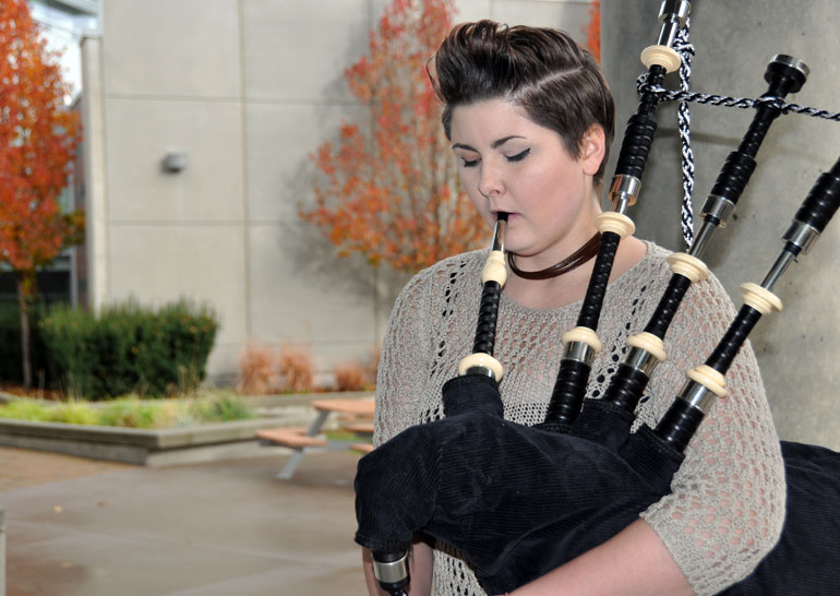 Brittany Crooks practices the bagpipes on campus. Crooks will be the official piper in UBC Okanagan's Remembrance Day event Monday, November 9.