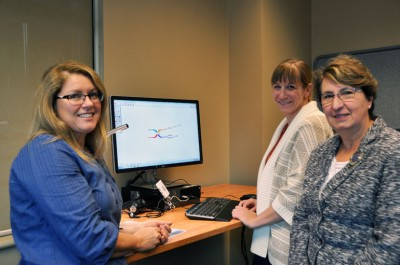 Earllene Roberts, with UBC Okanagan's Disability Resource Centre, and Barbara Sobol, undergraduate services librarian, demonstrate some of the equipment available at the campus's new Inclusive Technology Lab to Provost and Vice-Principal Academic of the Okanagan campus Cynthia Mathieson (right).