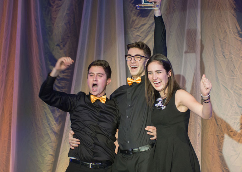 UBC Okanagan third-year Faculty of Management students (from left) Nick Ross, Graeme Sailor, and Jennifer Stolarchuk celebrate their first-place finish at JDC West for entrepreneurship. Photo courtesy JDC West 2016.