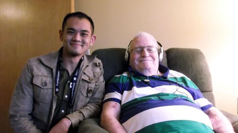 UBC Okanagan student Gary Su with one of the Baptist Housing clients he worked with during the Music and Memories project.