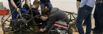 UBCO's Motorsports team prepares their car for the road ahead.
