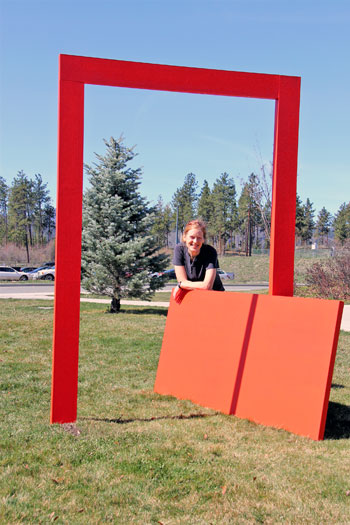 Faculty of Creative and Critical Studies student Patricia Leinemann poses with her sculpture which can be found near the grad student residences at UBC's Okanagan campus.