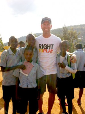 UBC Assist. Prof. Stephen Berg with school children in Rwanda.