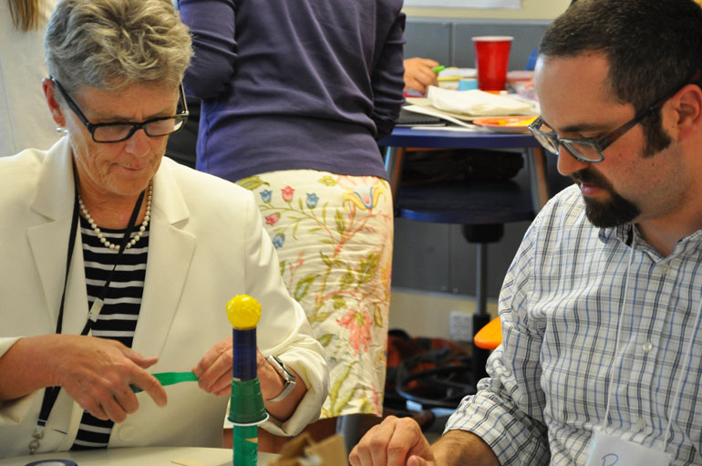 Jan Unwin (left), Superintendent of Graduation and Student Transitions with the Ministry of Education and the Ministry of Advanced Education, participates in a maker demonstration at UBC's Small Schools Think Tank this week. (
