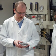 UBC Associate Professor Lukas Bichler (second from left) discusses how to extract minerals from mining byproducts with his students.