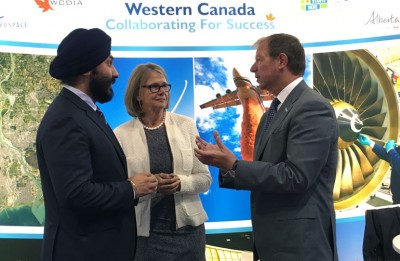 Avcorp CEO Peter George (right) discusses the new Learning Factory partnership with UBC Deputy Vice-Chancellor Deborah Buszard and Minister of Innovation, Science and Economic Development Navdeep Bains (left).