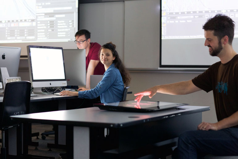 UBC Okanagan Instructor Miles Thorogood (right) shows students some of the technology that will be used in the new BMS program.