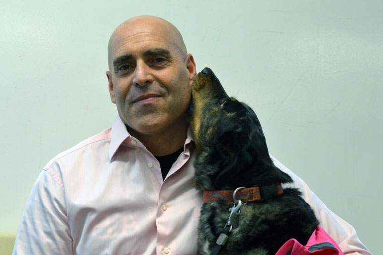 John Tyler Binfet, seen with his dog Frances, conducted a study on the effect of pet therapy on homesickness. Binfet runs the Building Academic Retention Through K'9s (B.A.R.K.) program at UBC's Okanagan campus.