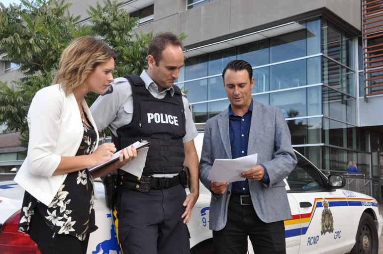 UBC PhD student Kimberly Kaseweter and Prof. Michael Woodworth share their sex offender classification report with Kelowna RCMP's Greg Willcocks.