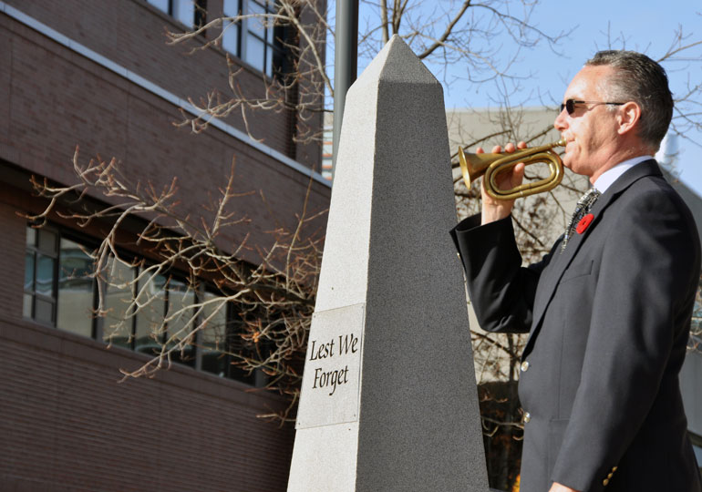 Dennis Colpitts plays the Last Post during a previous Remembrance Ceremony at UBC Okanagan.