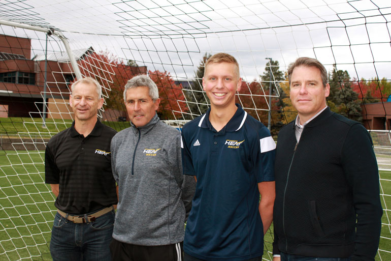 UBC Okanagan Director of Athletics Rob Johnson poses with Heat Men's soccer coach Dante Zanatta, 2016 Capri Scholarship winner Nicholas Reitsma, and Capri President Tim Miller.