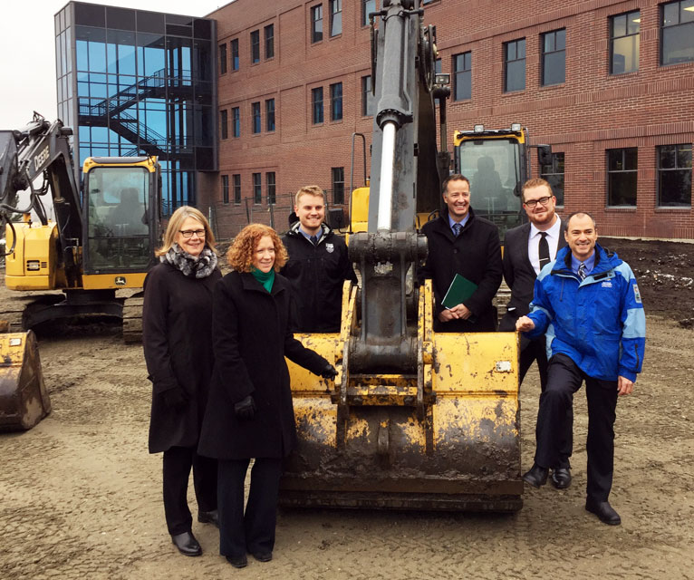 Deborah Buszard, UBC deputy vice-chancellor and principal, Okanagan campus, far left, poses on the construction site with chief librarian Heather Berringer, student union president Blake Edwards, MP Stephen Fuhr, MLA Norm Letnick, and former UBC Okanagan student union president Tom Macauley.