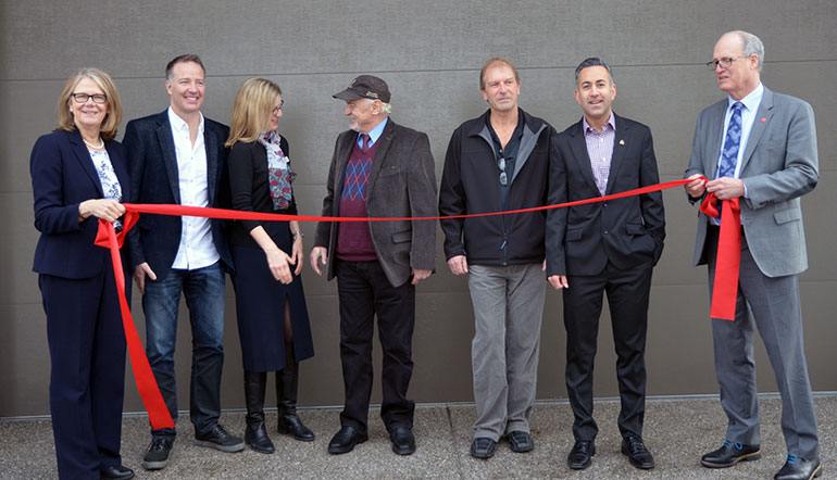 The official ribbon for the Home of Tomorrow was cut by UBC's Okanagan's Deputy Vice-Chancellor Deborah Buszard; Stephen Fuhr, MP Kelowna - Lake Country; Danielle Wensink, FortisBC; Russ Foster, CEO Blenk Development; Scott Tyerman, AuthenTech Homes; Colin Basran, Mayor City of Kelowna; Jim Hamilton, President, Okanagan College.