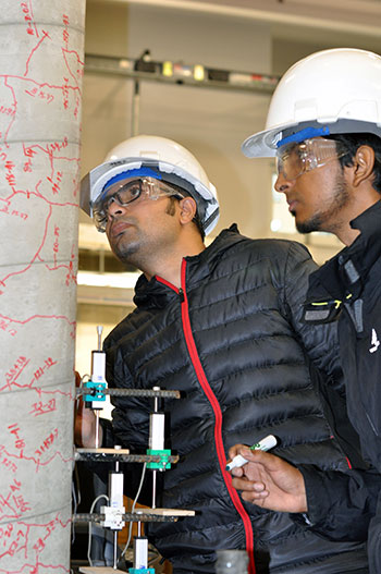 Test leader Mosharef Hossain, right, along with fellow UBC engineering student Rashedul Kabir, left, carefully inspect a concrete column after it has been put through a lengthy shake test at UBC Okanagan's Applied Laboratory for Advanced Materials and Structures.