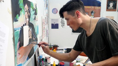 Bachelor of Fine Arts student Ben Arcega works on a painting in his studio. Ben's work is part of the BFA graduation exhibition taking place at UBC starting on April 13.