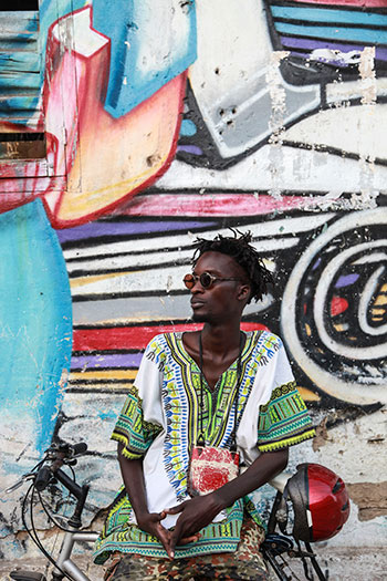 Senegalese rapper and musician Ibaaku wears a classic dashiki. Photo courtesy of Djibril Drame, taken in Dakar, Senegal October 2014.