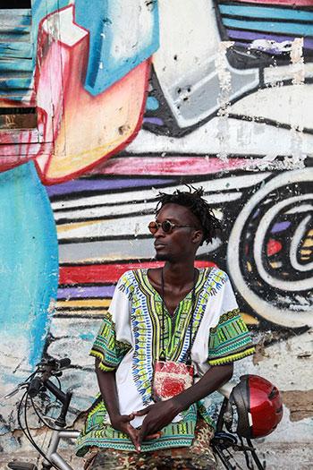 Senegalese rapper and musician Ibaaku wears a classic dashiki. Photo courtesy of Djibril Drame, taken in Dakar, Senegal October 2014.