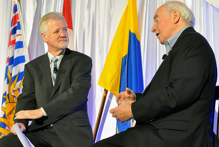 Pat Kennedy (left) chats with special guest Doug Mitchell at the Valley First/UBC Okanagan Athletics Scholarship Breakfast Friday morning.
