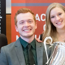 Management students (from left) Jonathan Donahoe, Alan Blackwell, Kirsten Haayer and Olivia Johnson hold the Argus Cup after winning the 2017 Live Case Challenge.