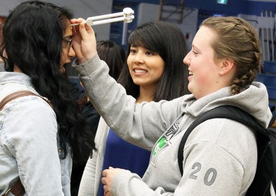 First-year UBC medical student Stephanie Schindler (middle) leads hands-on activity for students at LV Rogers Secondary in Nelson as part of the Healthcare Travelling Roadshow.