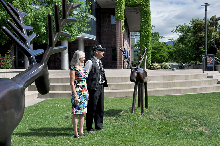 "Louise Sidley, left, and David Sidley speak to family and friends gathered after the sculpture ""Two Deer"" was officially unveiled at UBC's Okanagan campus."