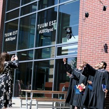 2017 graduates throw their mortarboards into the air to celebrate their success after receiving their degrees.