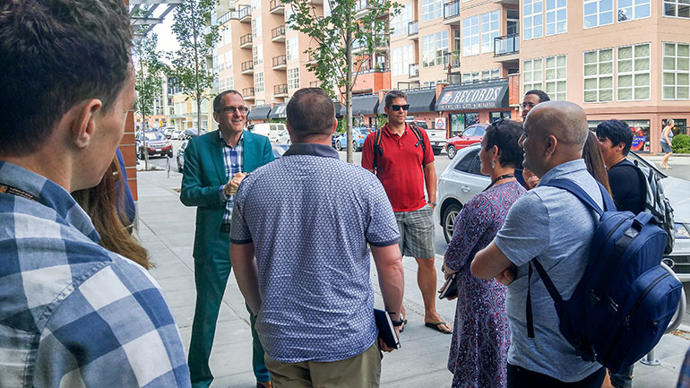 Master of Management students tour downtown Kelowna with City of Kelowna Director of Business and Entrepreneurial Development Robert Fine as part of their two week-long summer intensive.