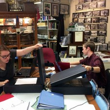 UBC students Emma Smith, left, and Eamon Riordan-Short scan historical material at Peachland's museum as part of the Okanagan Region Historical Digitization Project.