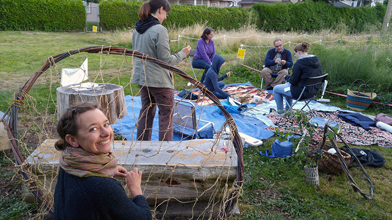 Artist and sculptor Annabel Stanley, foreground, shows participants how to make coiled bumblebee 'pots' during a recent Pollinator Pasture event.