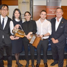 From left, lecturer Svan Lembke, David Gao, Stehaniya Mikhaylova, Marisa Matthews, Dan Thornton, Argus Properties President Ted Callahan and Faculty of Management Director Mike Chiasson celebrate with the Argus Cup after the 2018 Live Case Challenge.