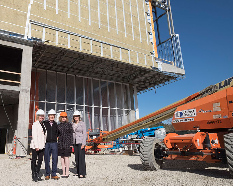 From left: Linda Fitzpatrick, Ross Fitzpatrick, UBC Okanagan Chief Librarian Heather Berringer and UBC's Deputy Vice-Chancellor Deborah Buszard pose for a photo outside the still under construction Teaching and Learning Centre.