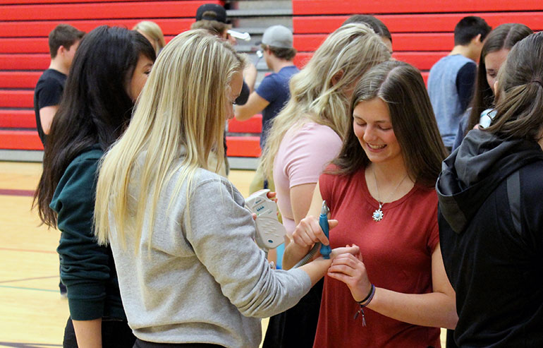 Students at JL Crowe Secondary in Trail listen to each other's heartbeat with portable ultrasound devices during the 2017 roadshow.