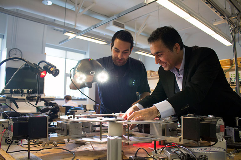 Engineering professor Abbas Milani and graduate student Armin Rashidi use 3D scanning equipment to analyze textile composites.